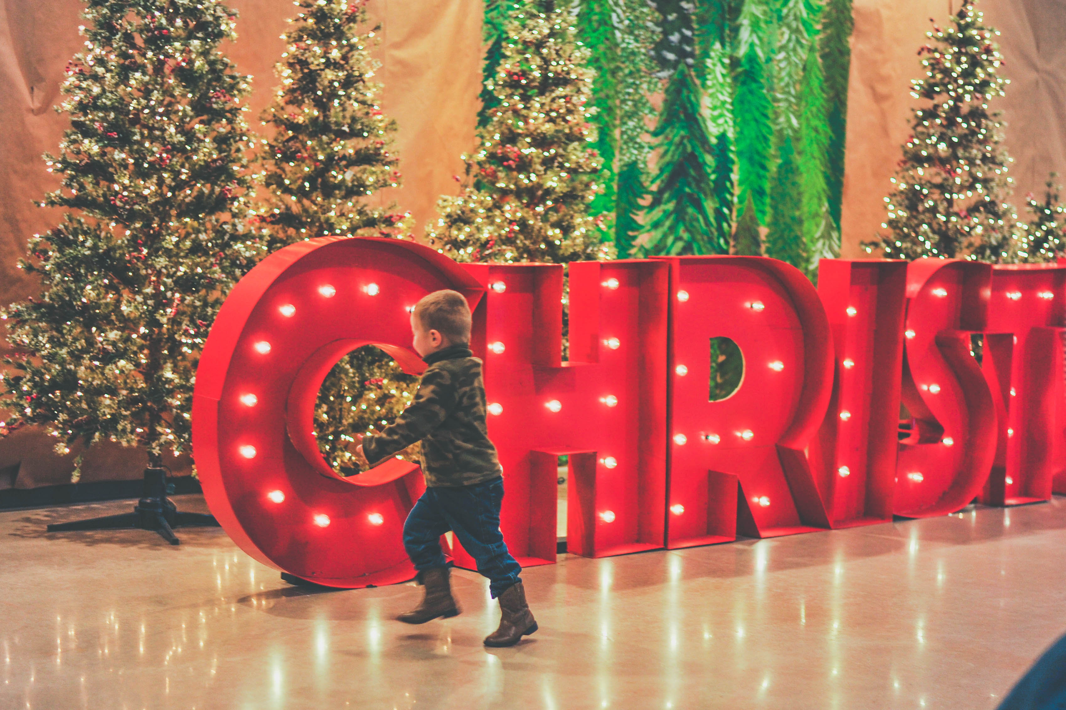 Child with Christmas Sign (JPG)